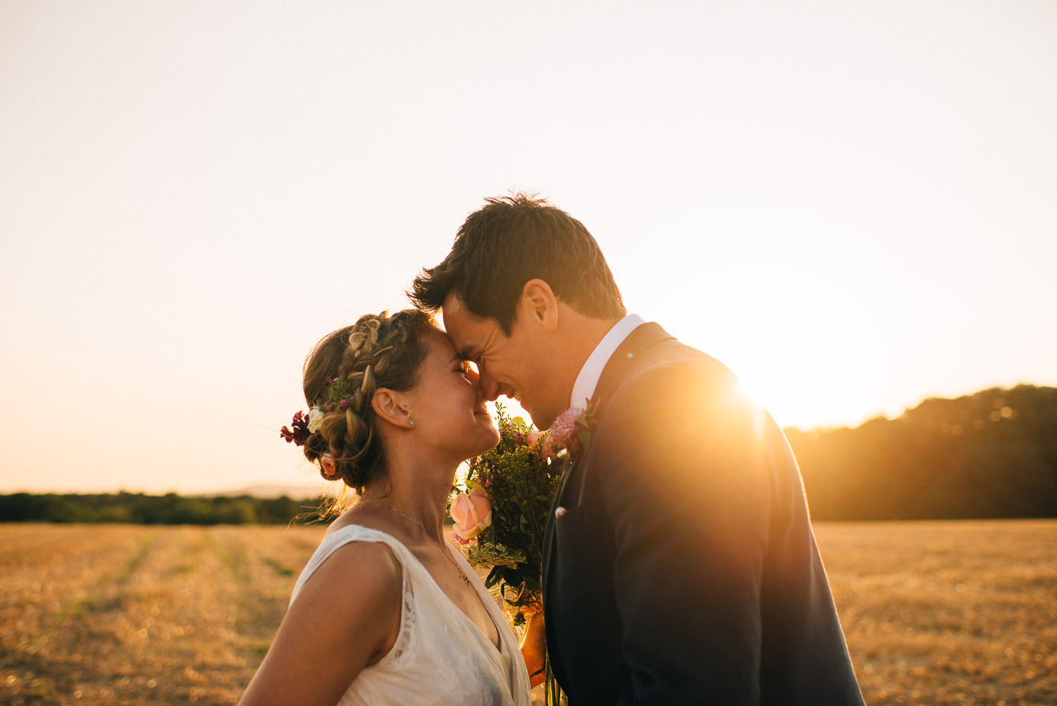 sunset couple with bride in charlie bread dress by creative and alternative london wedding photographer the shannons photography