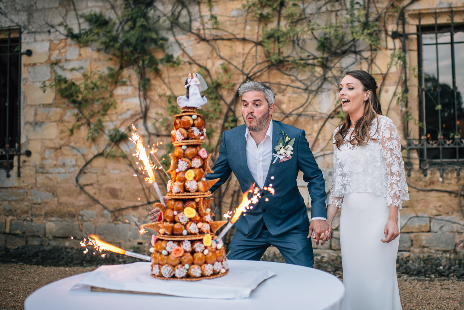 cake cutting at french wedding chateau de bourlie by creative and alternative london wedding photographer the shannons photography