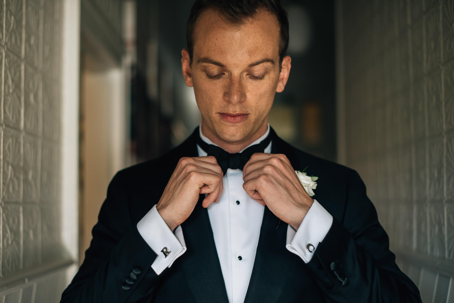 groom getting ready in the yarra valley by creative and alternative london wedding photographer the shannons photography