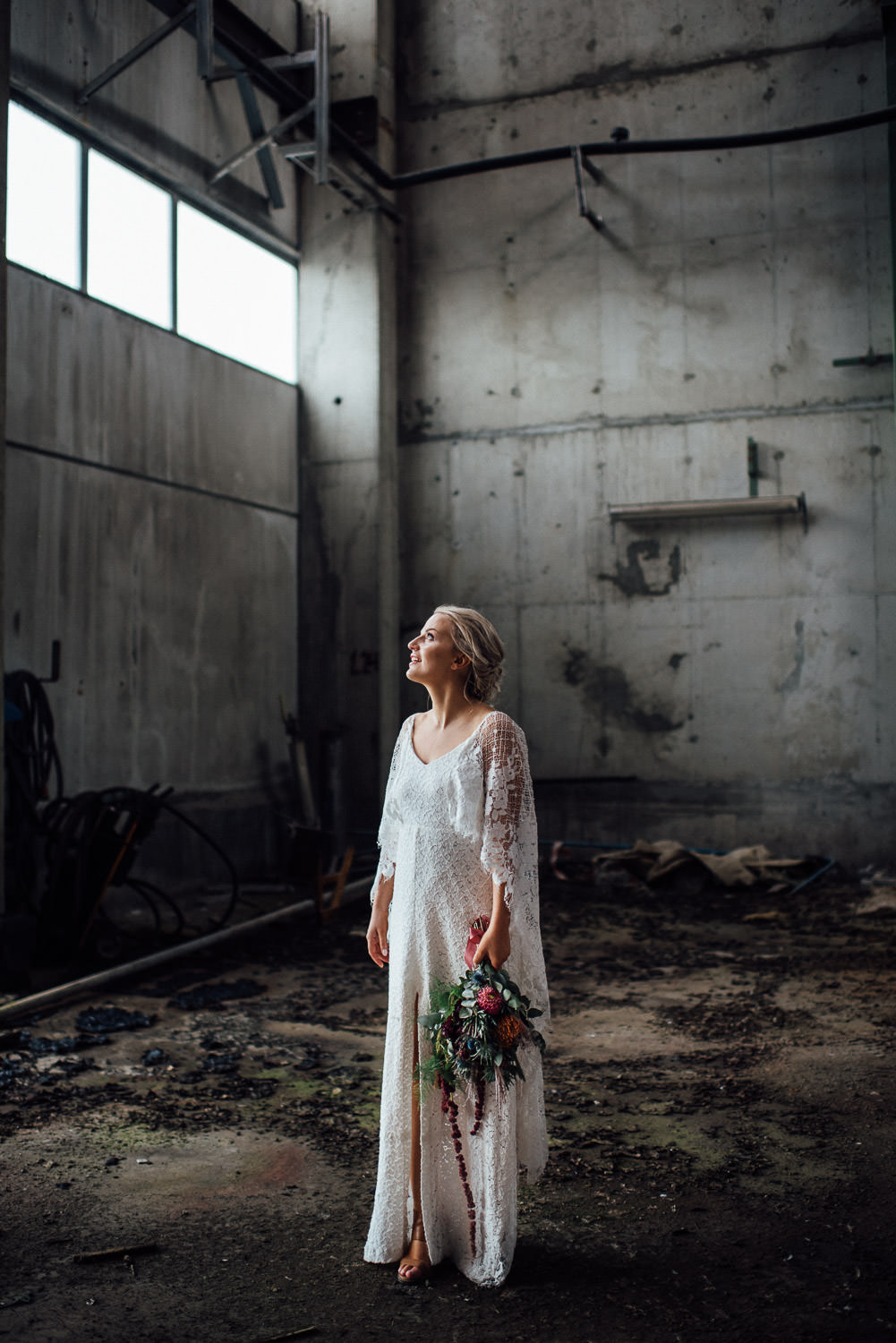 bride in abandoned warehouse by creative and alternative london wedding photographer the shannons photography