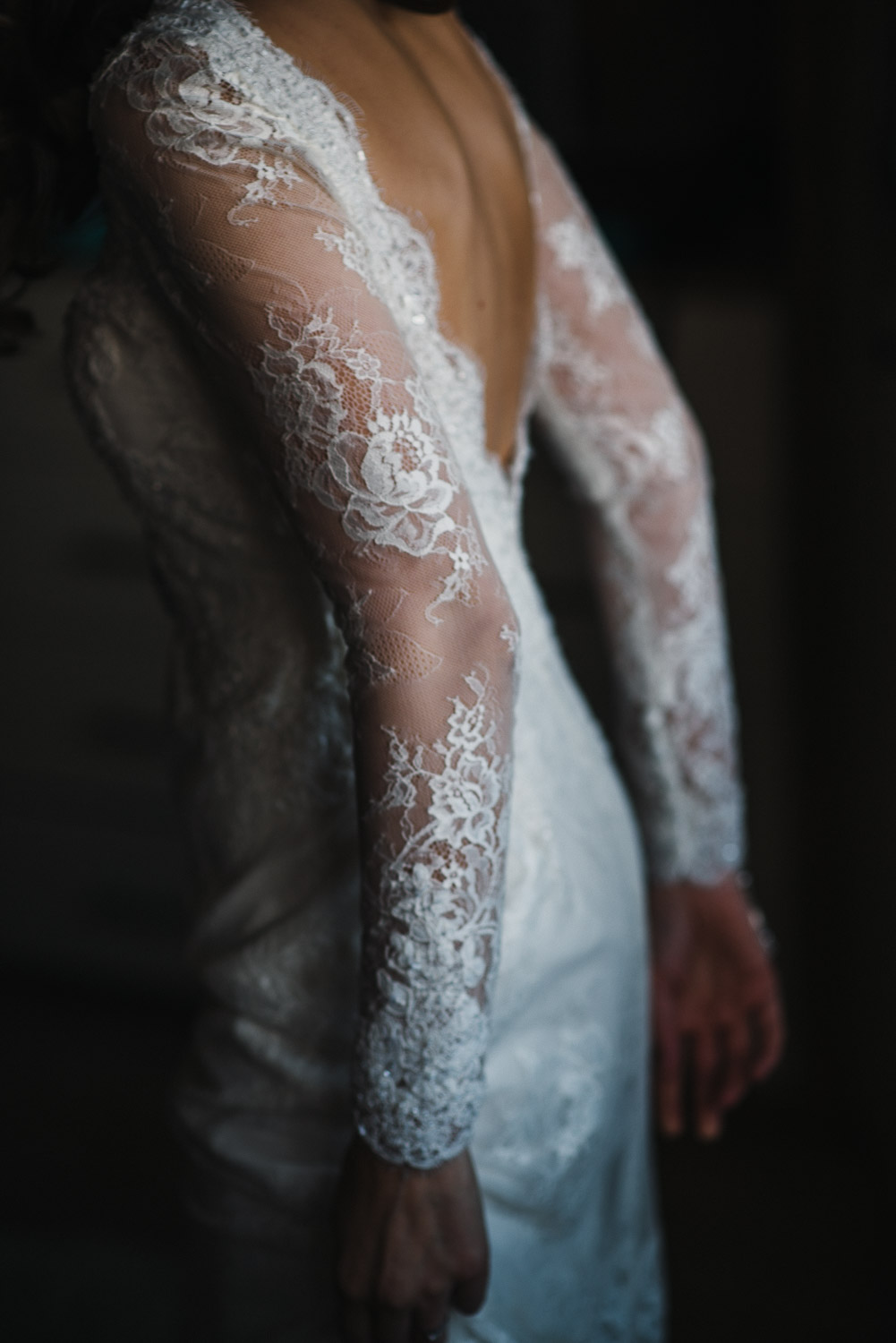 backless lace dress detail by creative and alternative london wedding photographer the shannons photography