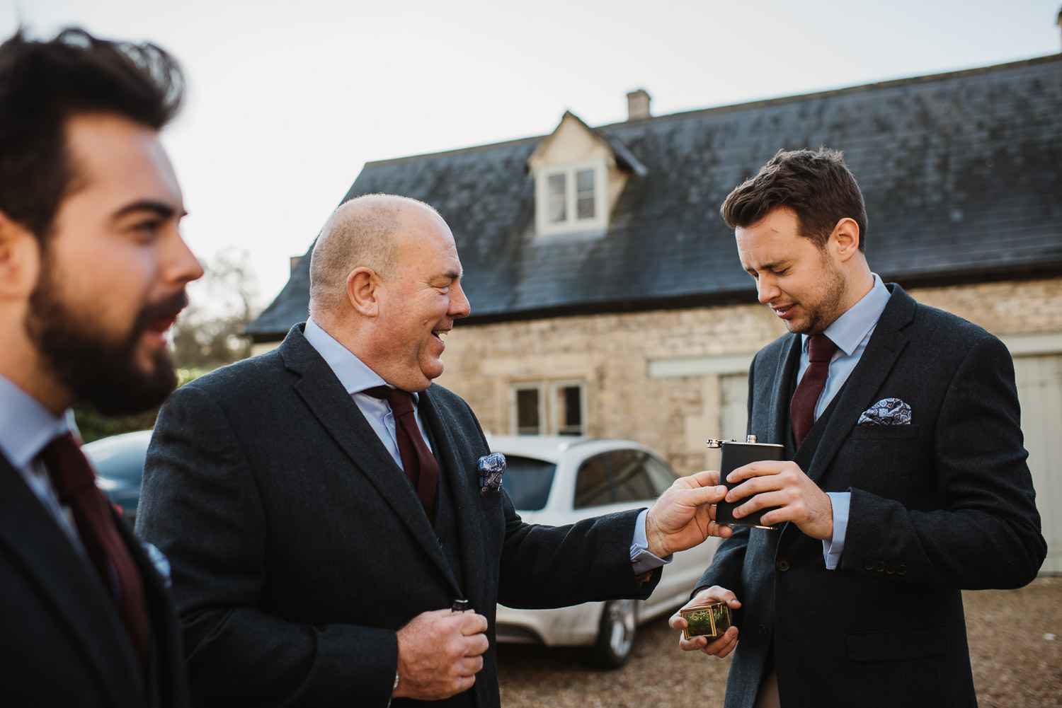groom having whiskey at cripps barn by creative and alternative london wedding photographer the shannons photography