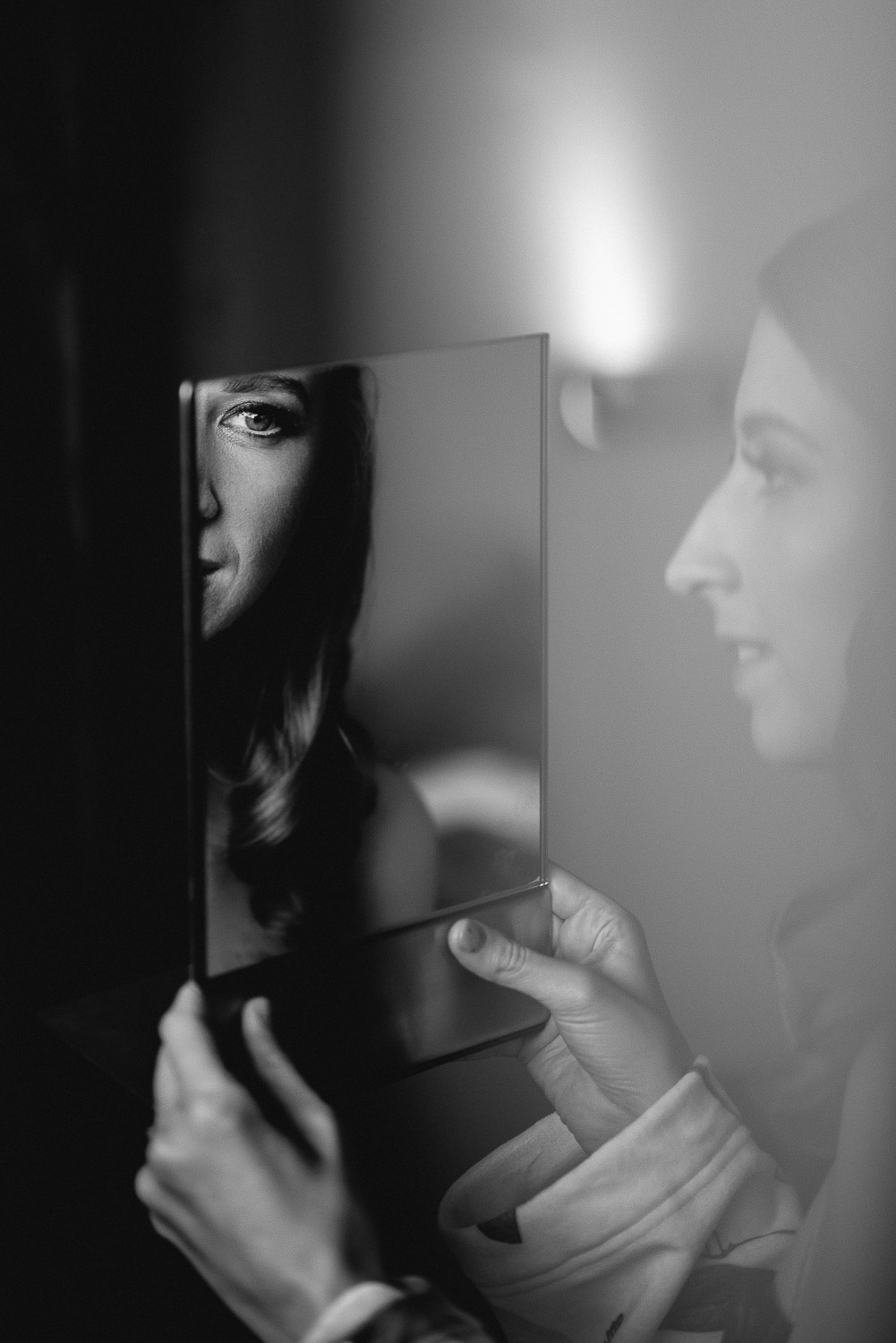 bride looking in the mirror by creative and alternative london wedding photographer the shannons photography