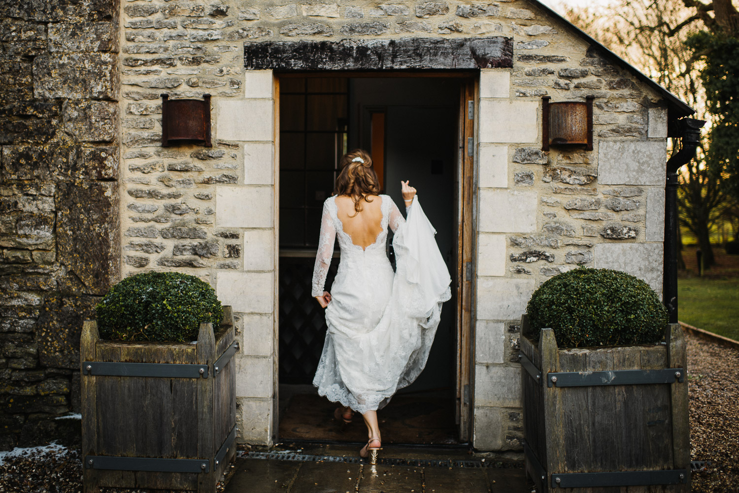 bride arriving at cripps barn by creative and alternative london wedding photographer the shannons photography