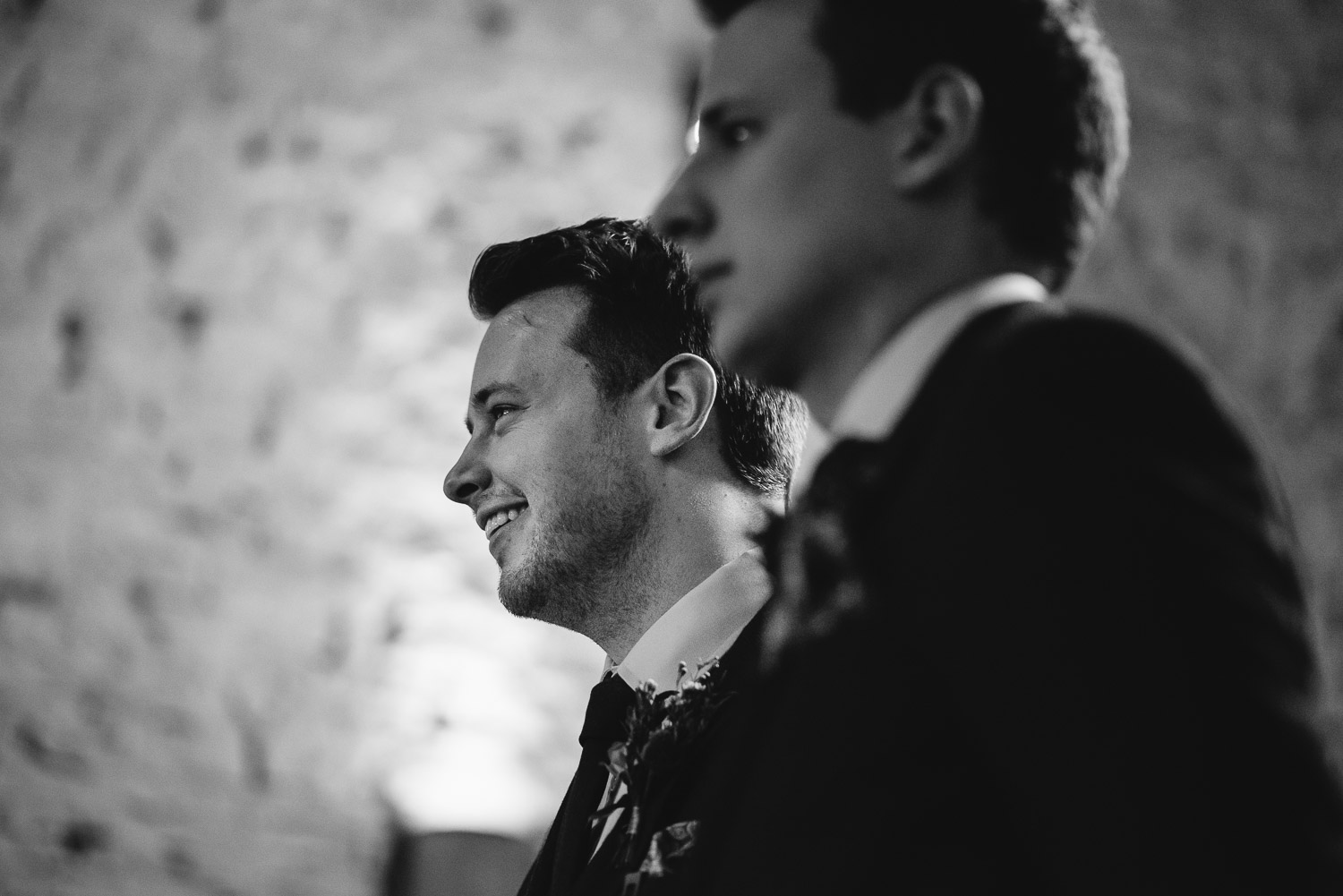 groom waiting for bride to arrive cripps barn by creative and alternative london wedding photographer the shannons photography