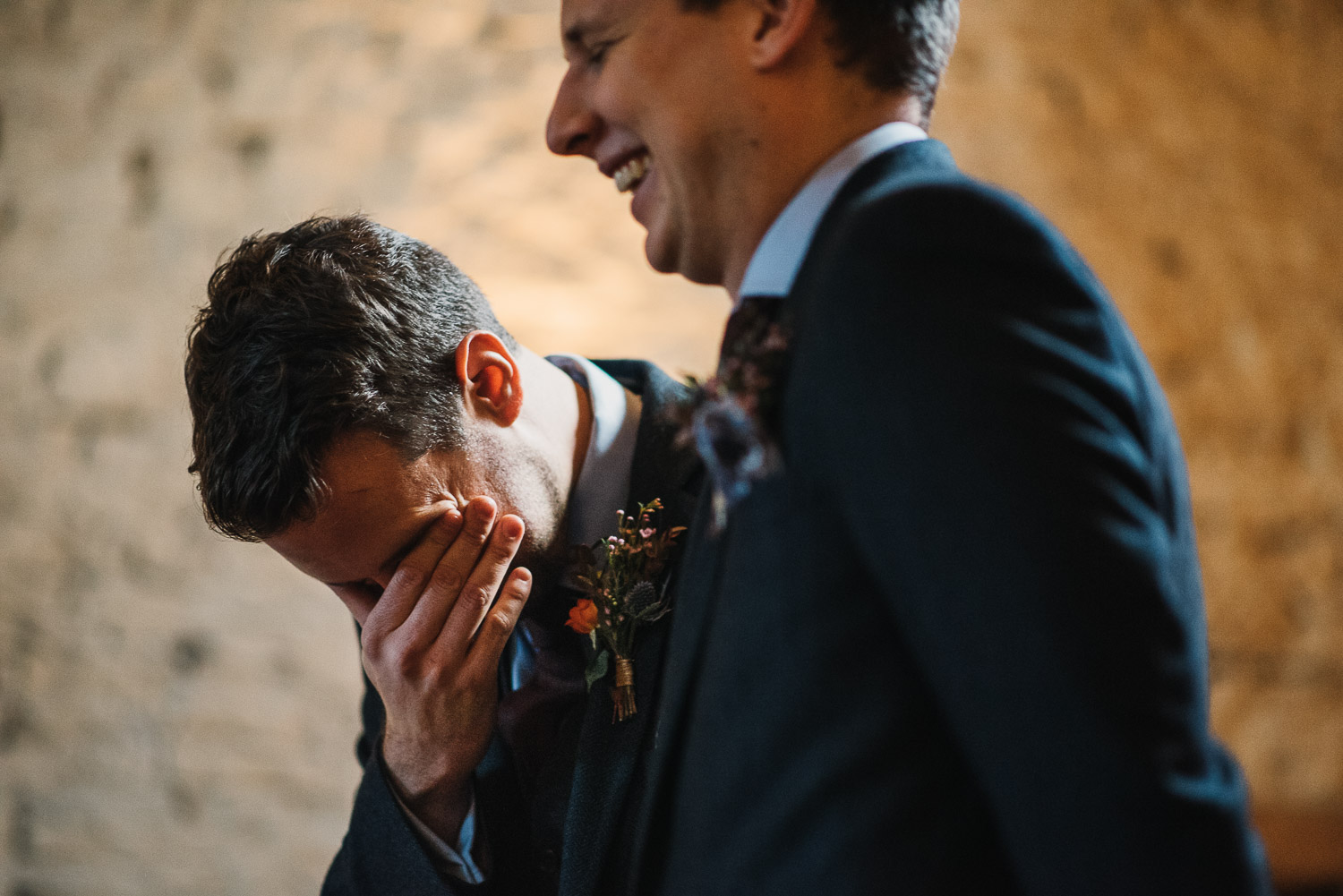 groom waiting nervously at cripps barn by creative and alternative london wedding photographer the shannons photography