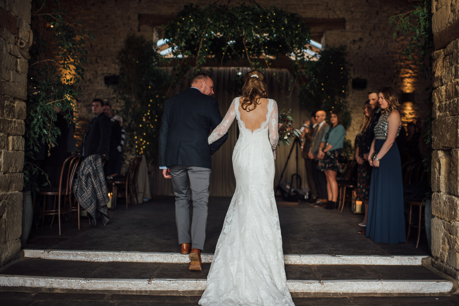 bridal entrance to cripps barn by creative and alternative london wedding photographer the shannons photography