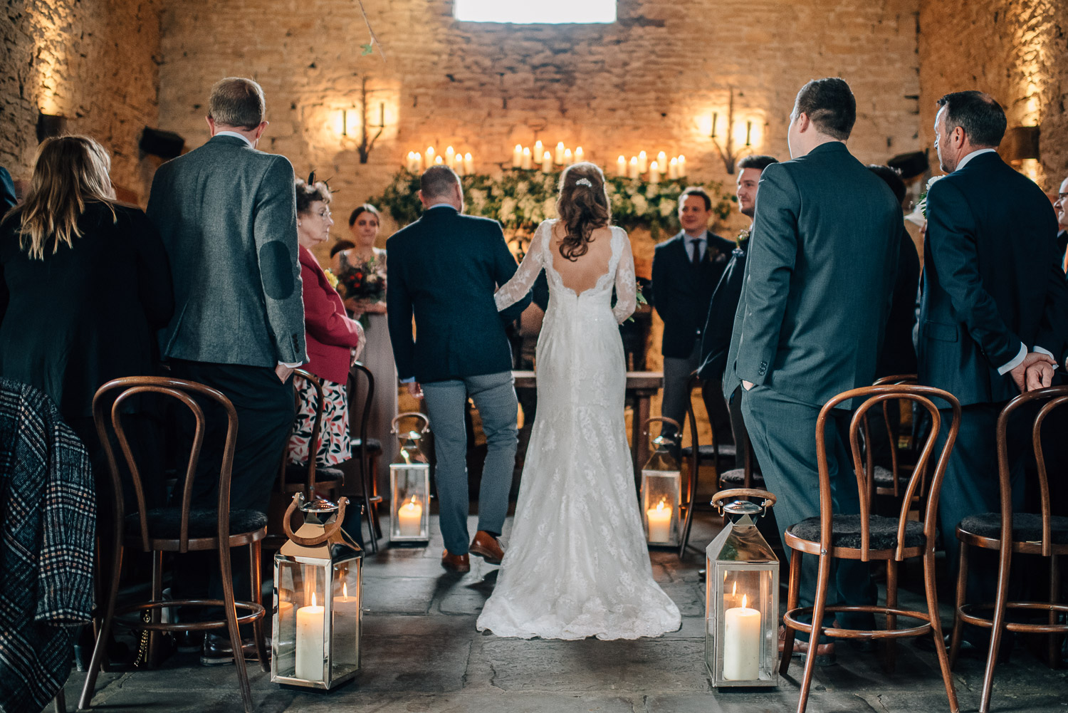 bride walking down the aisle by creative and alternative london wedding photographer the shannons photography