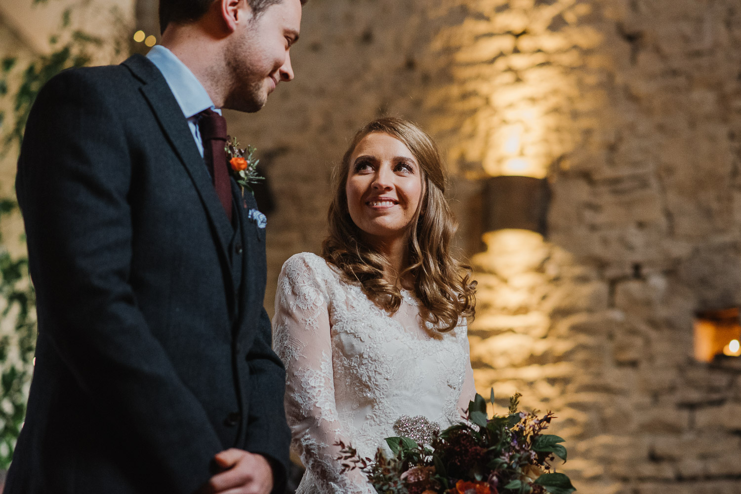bride smiling at groom by creative and alternative london wedding photographer the shannons photography