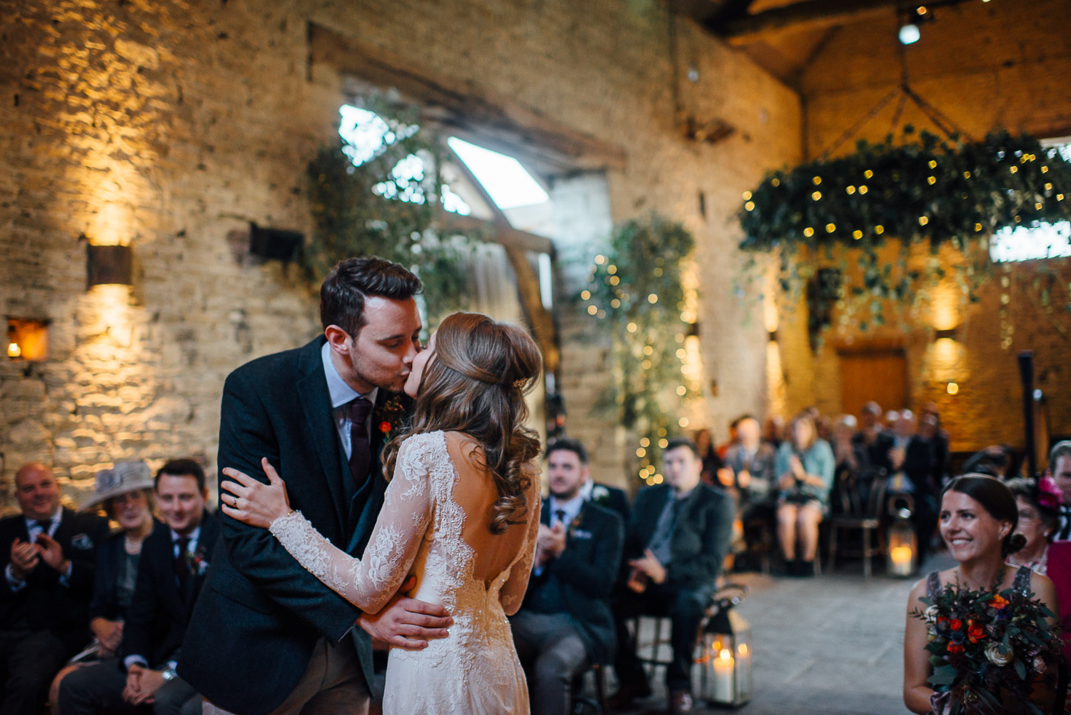 bride and groom kissing cripps barn by creative and alternative london wedding photographer the shannons photography