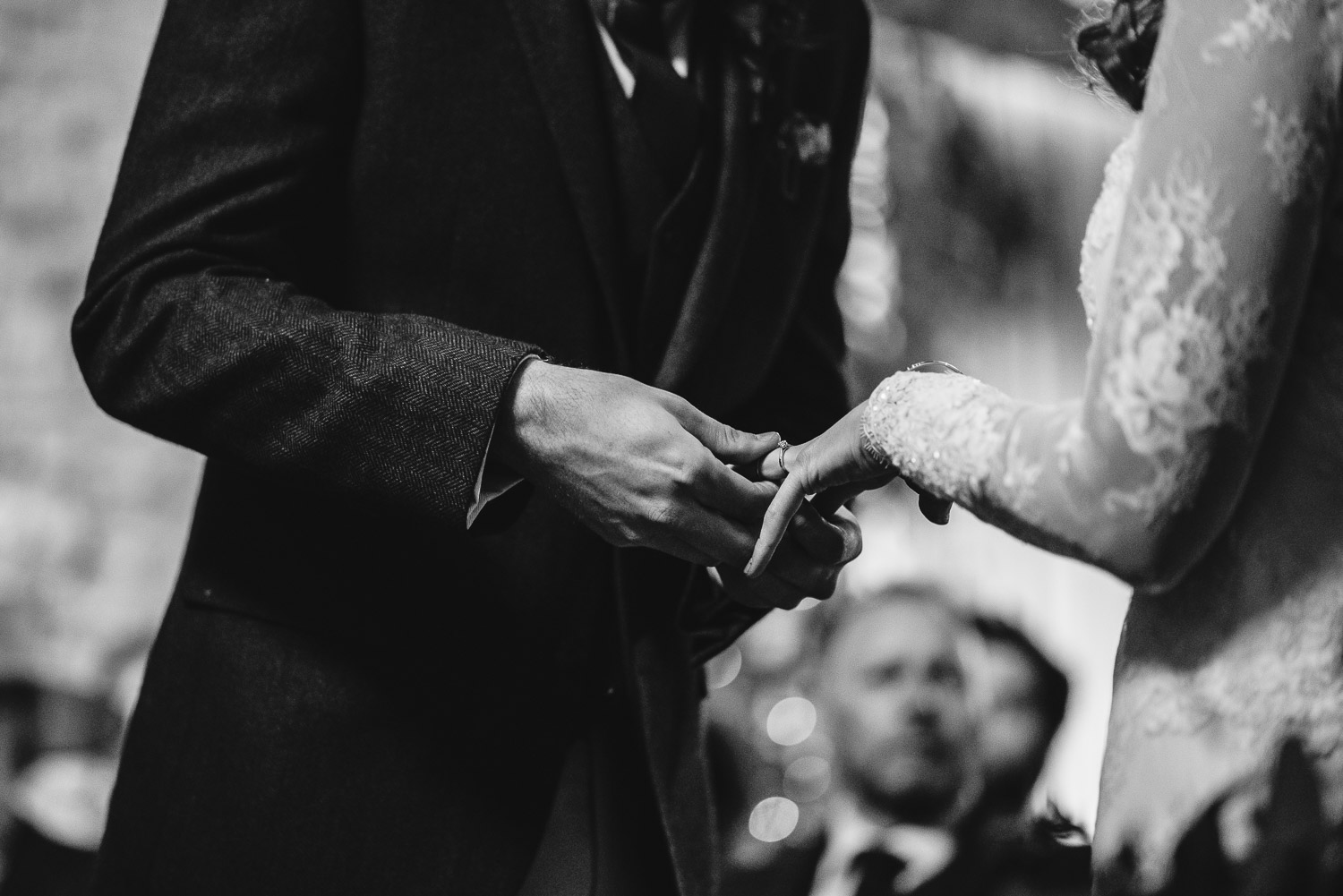 exchanging rings at cripps barn by creative and alternative london wedding photographer the shannons photography