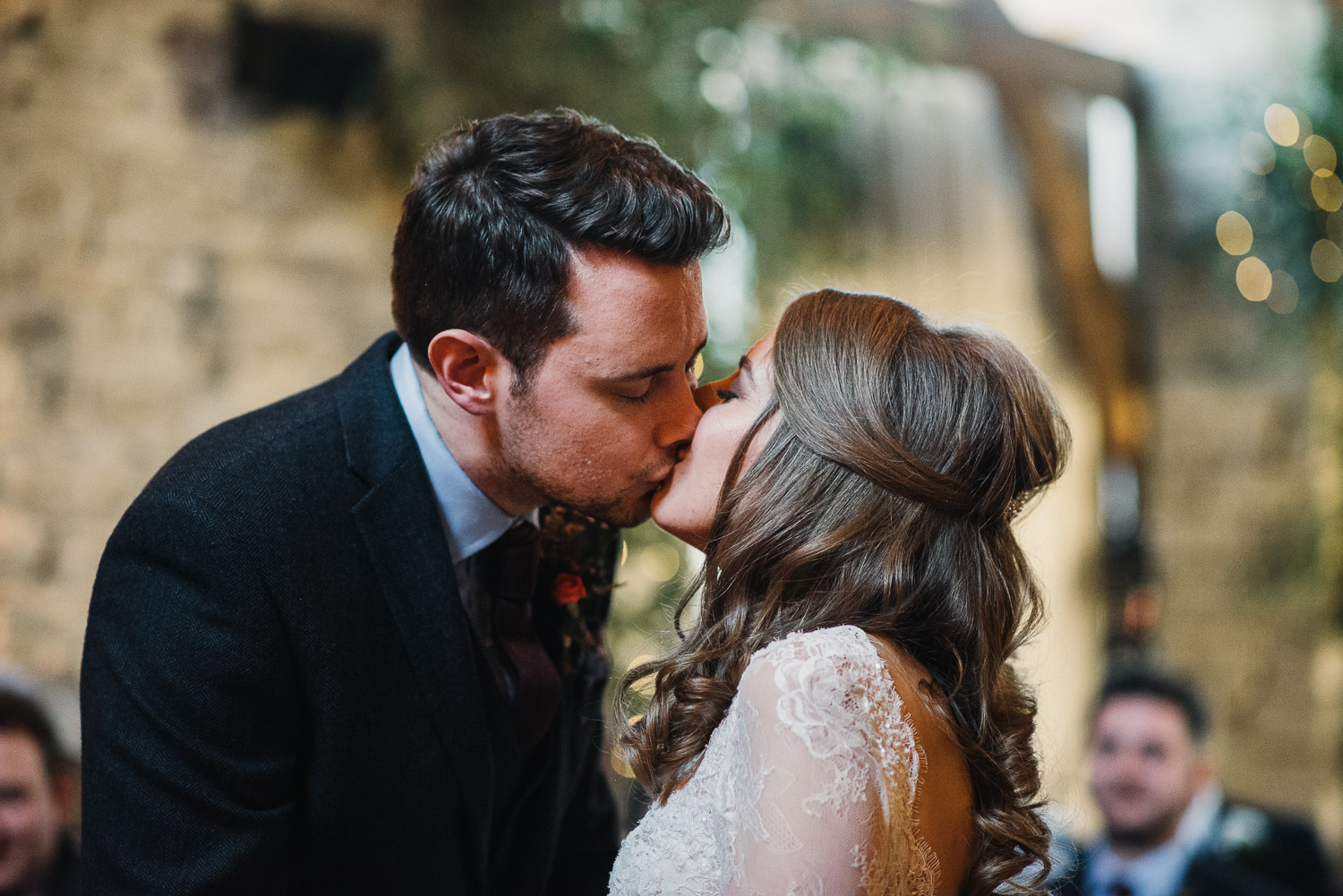 bride and groom first kiss by creative and alternative london wedding photographer the shannons photography