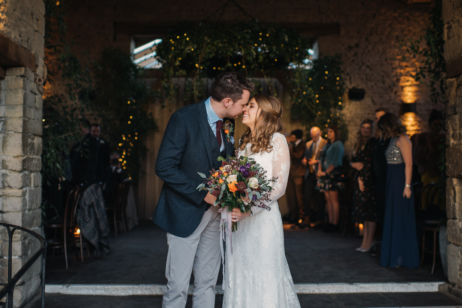 bride and groom smiling at cripps barn by creative and alternative london wedding photographer the shannons photography