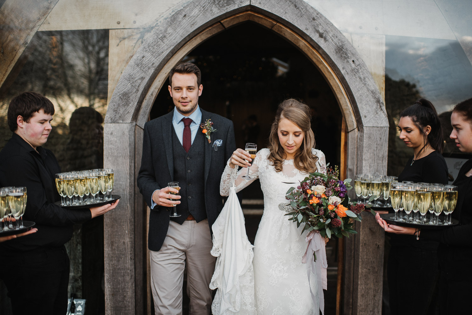 champagne toasts at cripps barn by creative and alternative london wedding photographer the shannons photography