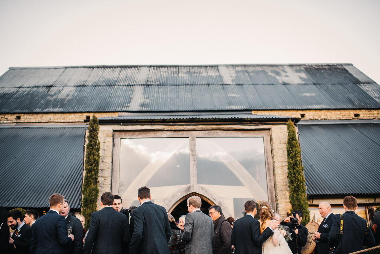 cripps barn stone barn by creative and alternative london wedding photographer the shannons photography
