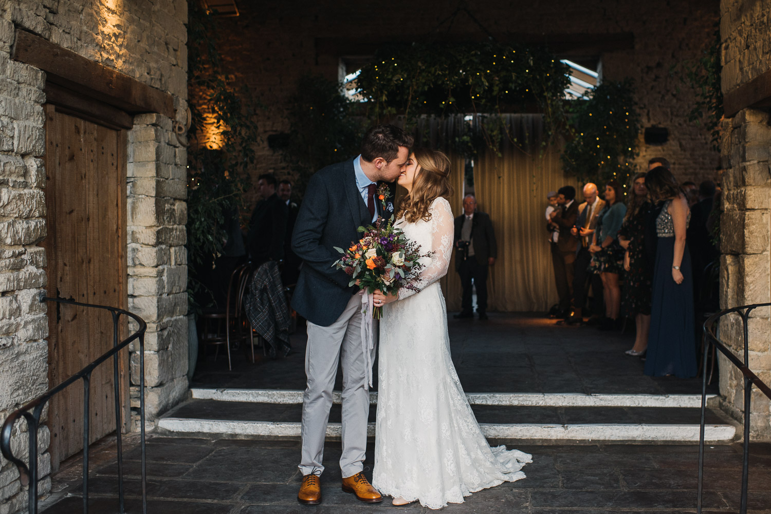 bride and groom leaving cripps barn by creative and alternative london wedding photographer the shannons photography