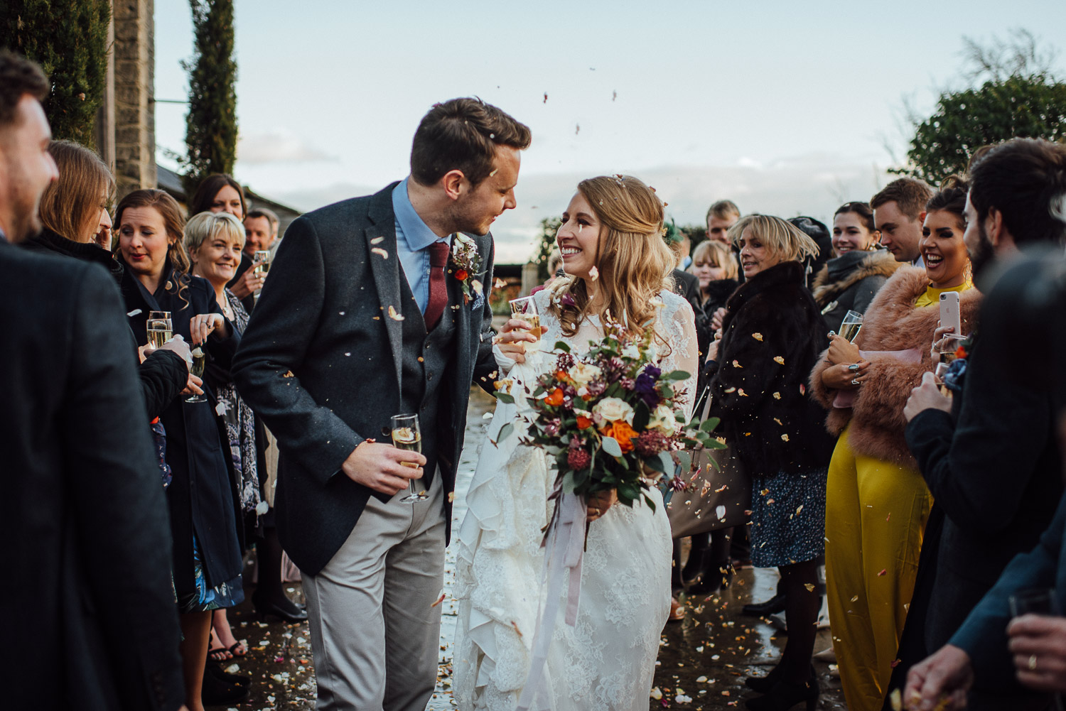 rose petal confetti at cripps barn by creative and alternative london wedding photographer the shannons photography