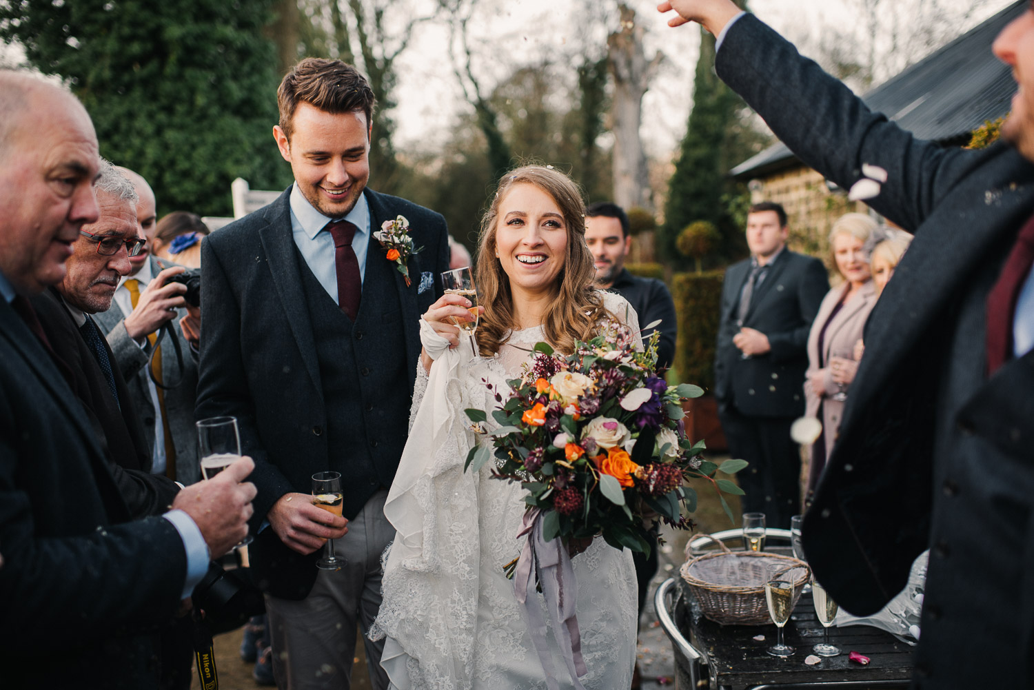 laughing and confetti throw by creative and alternative london wedding photographer the shannons photography