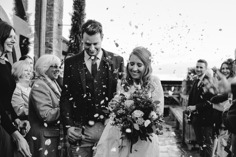 cripps barn confetti throw by creative and alternative london wedding photographer the shannons photography