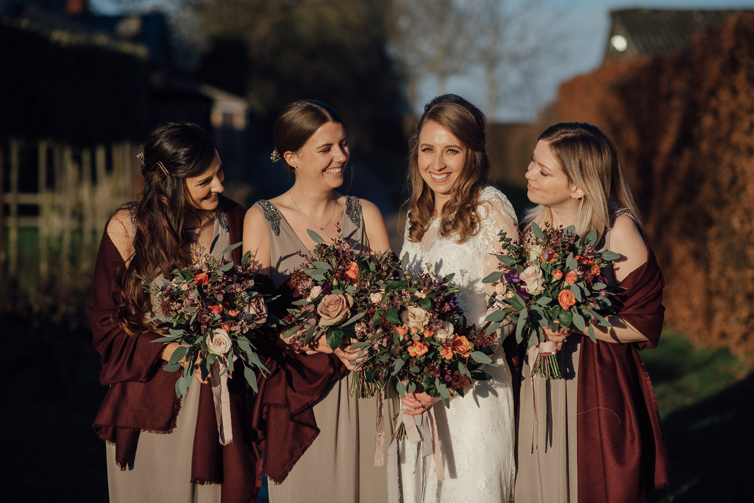 bridesmaids smiling at cripps barn by creative and alternative london wedding photographer the shannons photography
