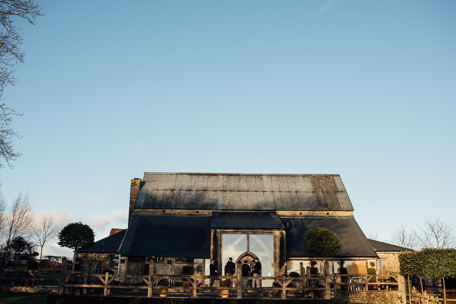 cripps barn at sunset by creative and alternative london wedding photographer the shannons photography