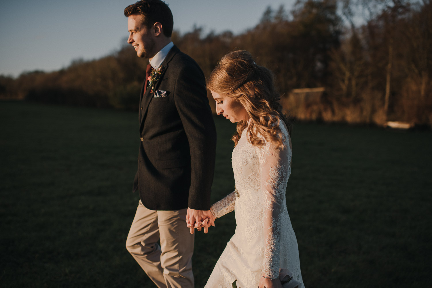 bride and groom watching the sunset by creative and alternative london wedding photographer the shannons photography