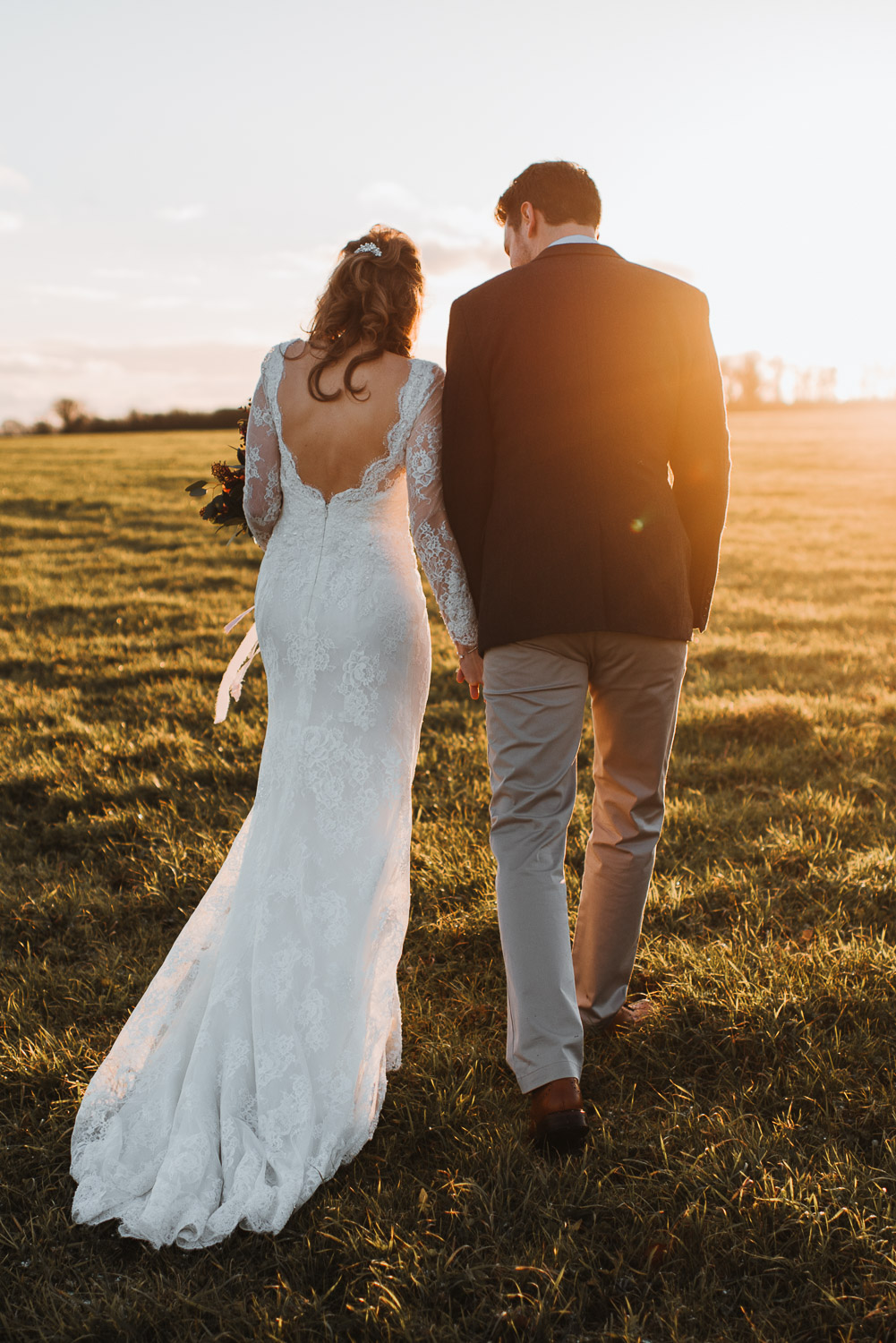 sunset walk at cripps barn by creative and alternative london wedding photographer the shannons photography
