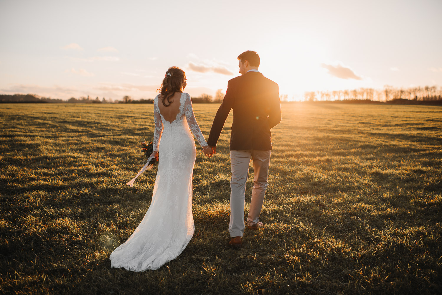 sunset walk and brides backless dress by creative and alternative london wedding photographer the shannons photography