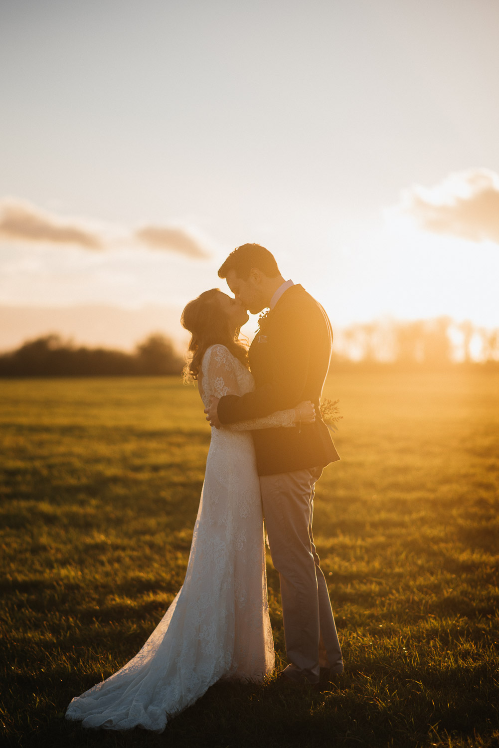 winter sunset with bride and groom by creative and alternative london wedding photographer the shannons photography