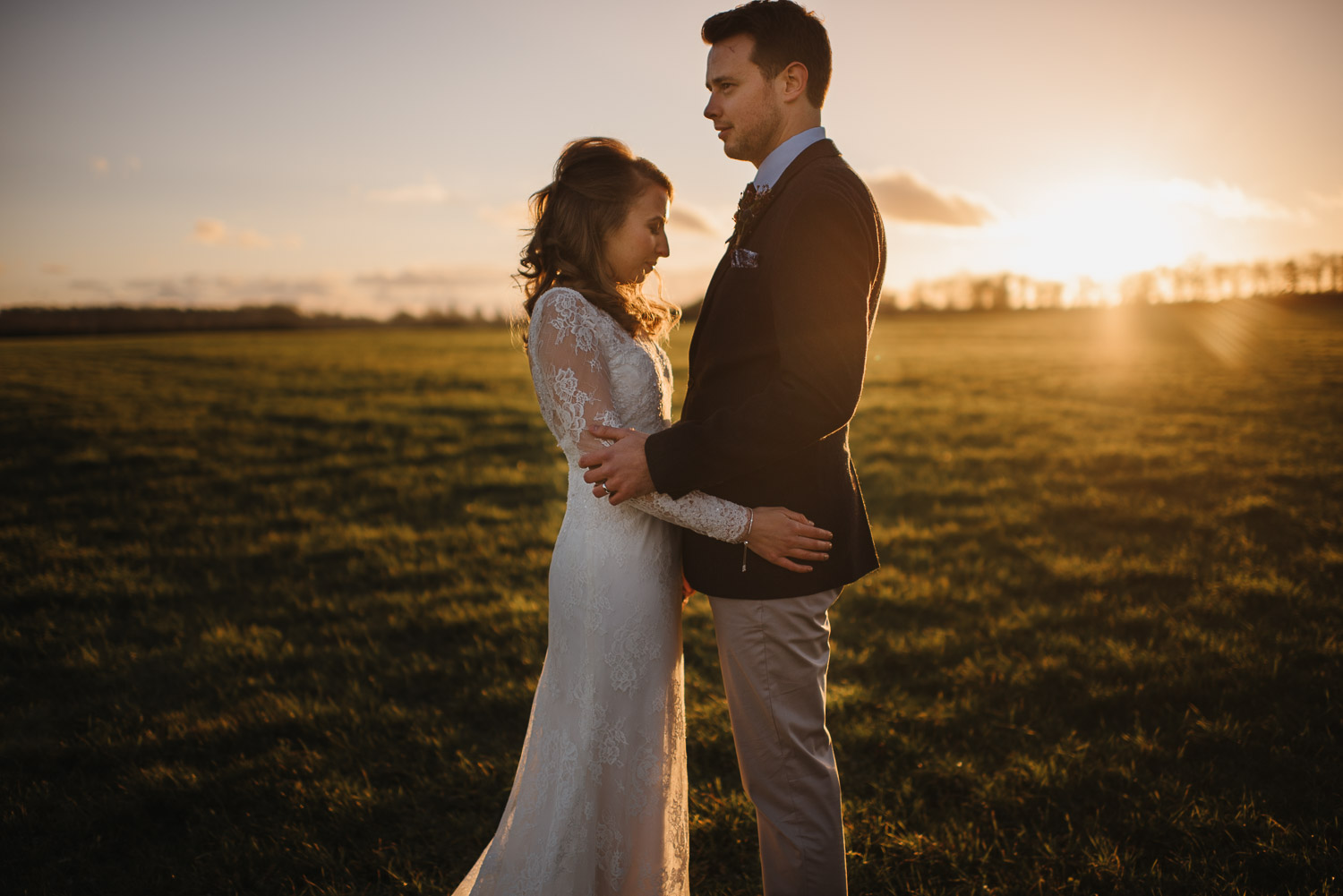 cripps barn sunset with bride and groom by creative and alternative london wedding photographer the shannons photography