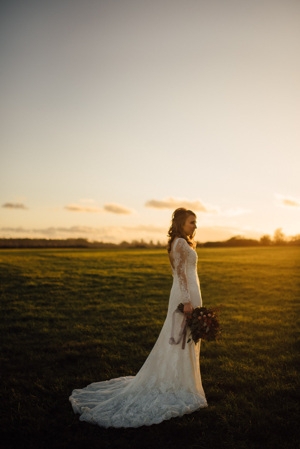 bride in lace dress during golden hour by creative and alternative london wedding photographer the shannons photography