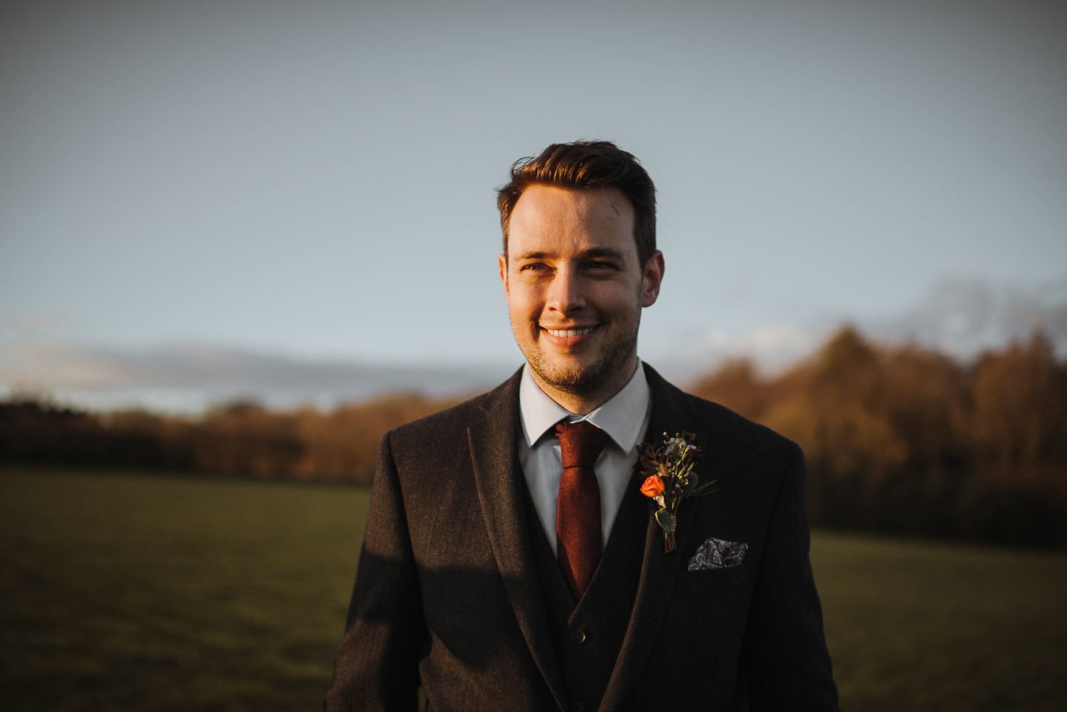 groom smiling at bride by creative and alternative london wedding photographer the shannons photography
