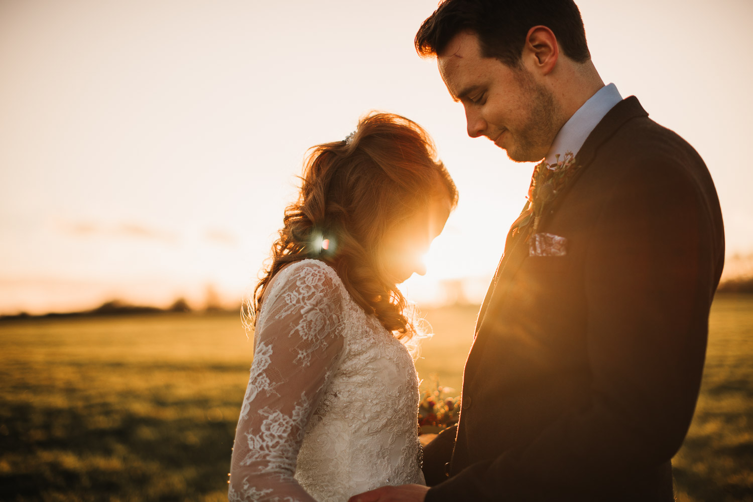 bride and groom sunset portraits by creative and alternative london wedding photographer the shannons photography