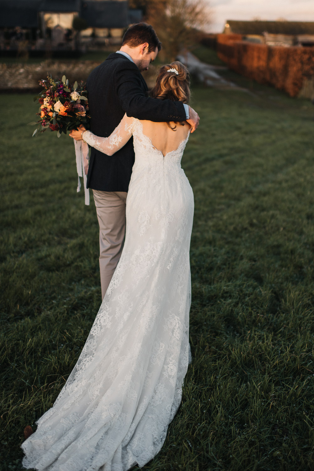 bride and groom cuddling at sunset by creative and alternative london wedding photographer the shannons photography