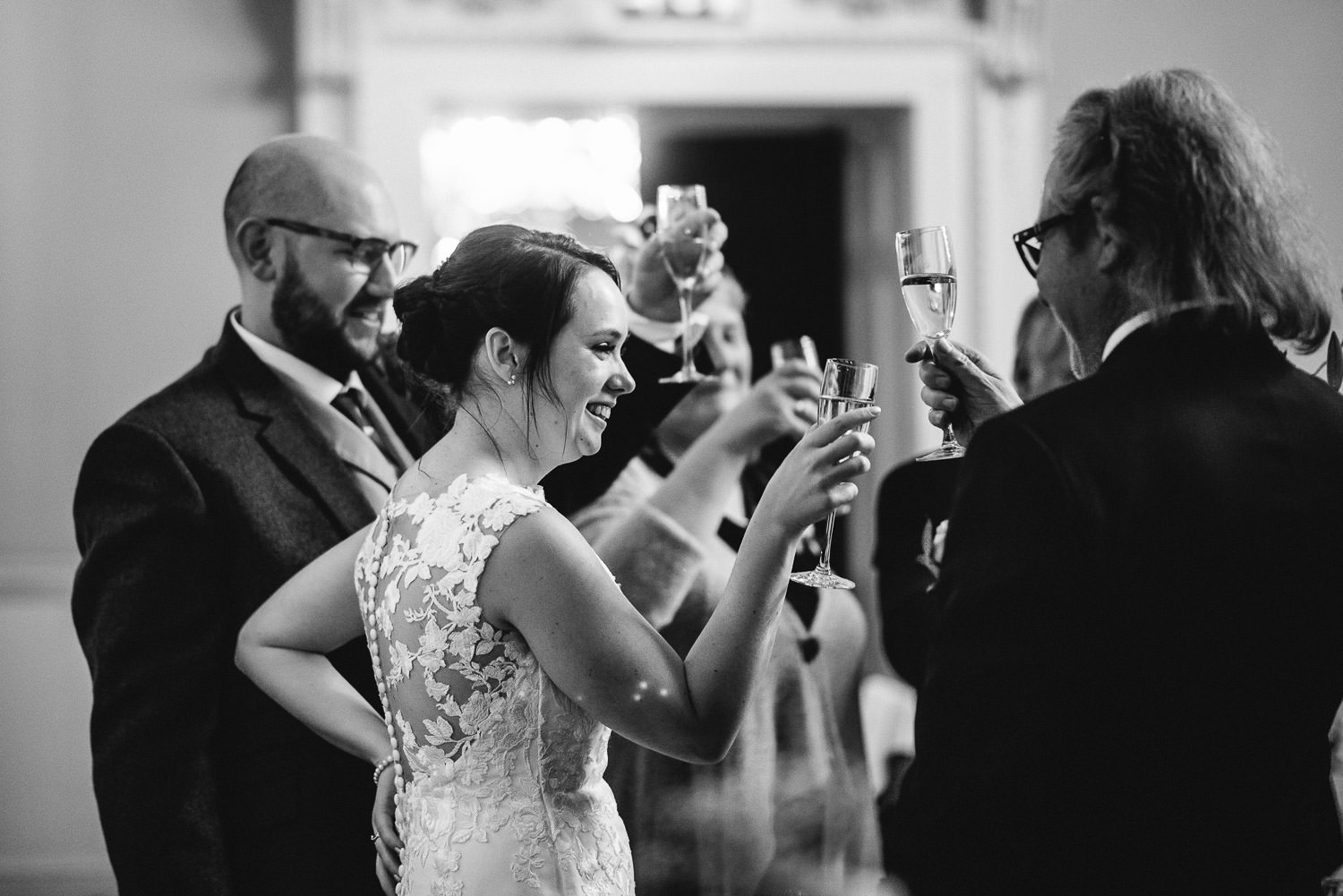 toasting the bride and groom by bath wedding photographer the shannons photography