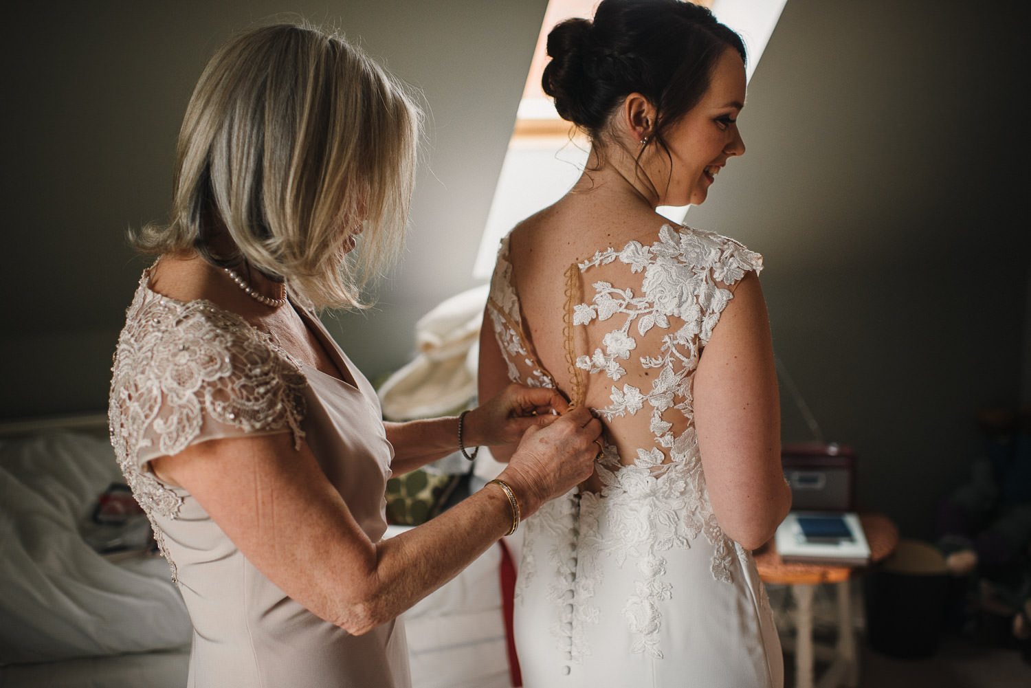 mother doing up brides pronovias dress by bath wedding photographer the shannons photography