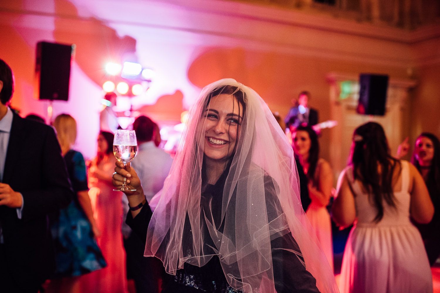 guest wearing wedding veil by bath wedding photographer the shannons photography