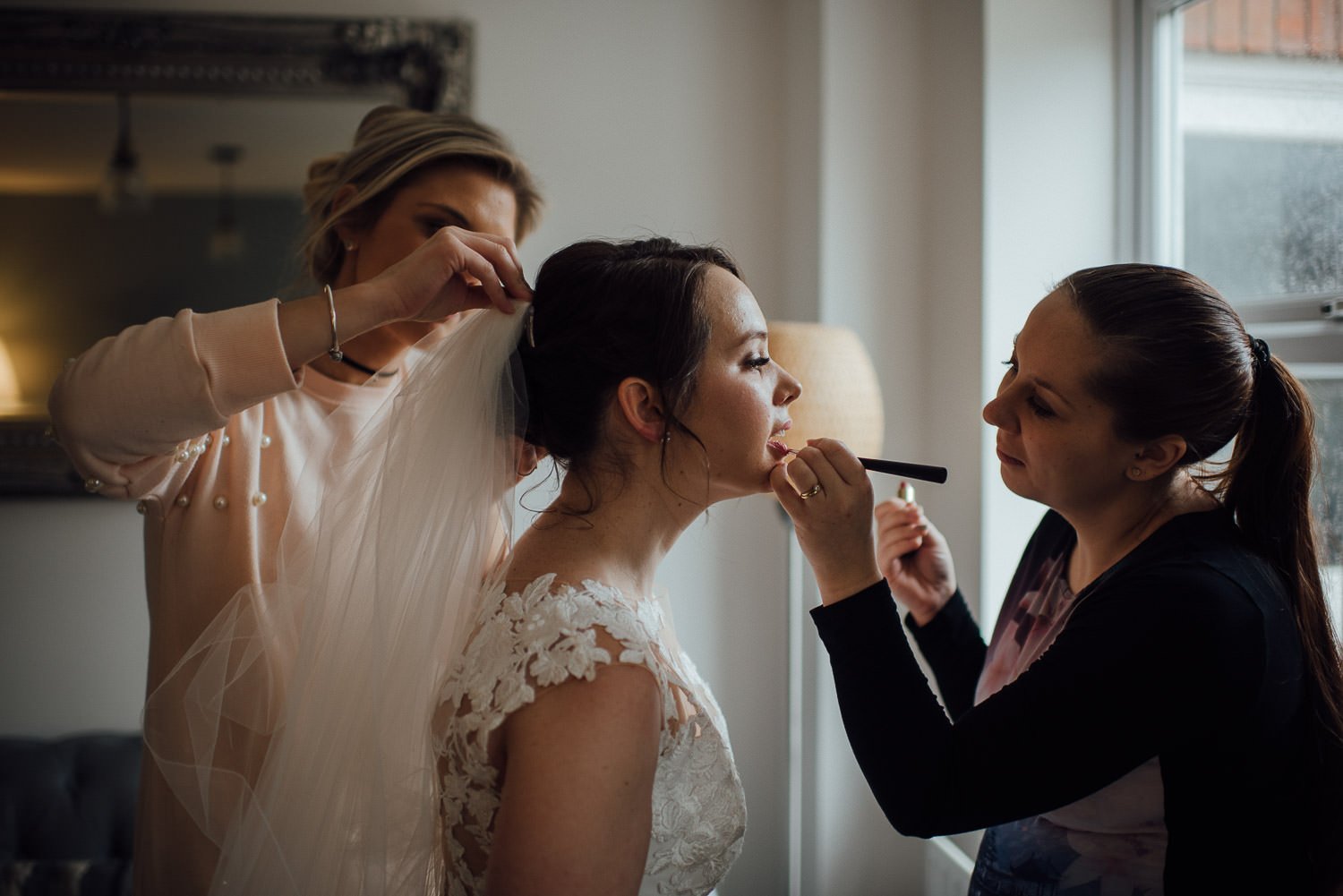 bride having lipstick done by bath wedding photographer the shannons photography