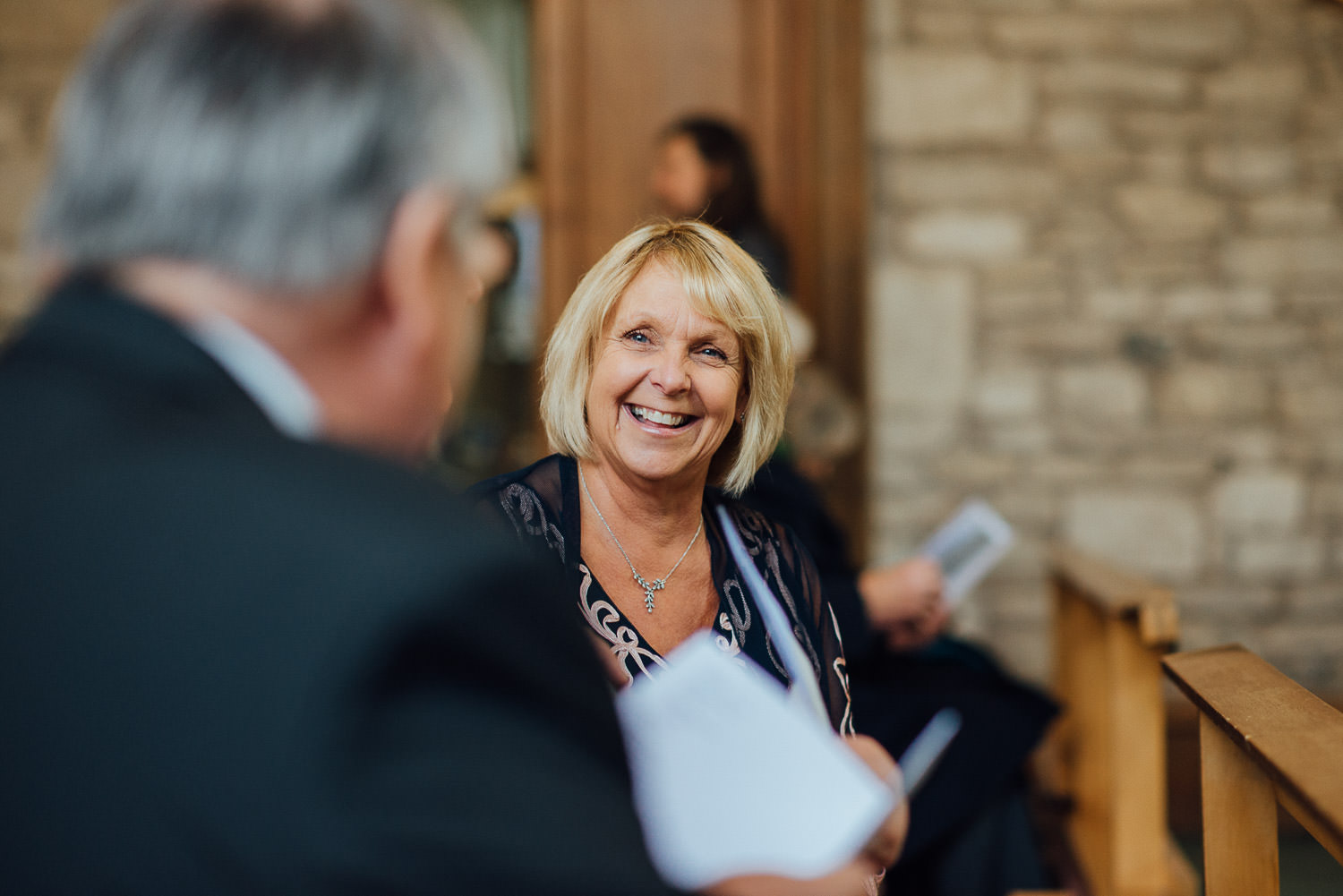 guest laughing at ceremony by bath wedding photographer the shannons photography