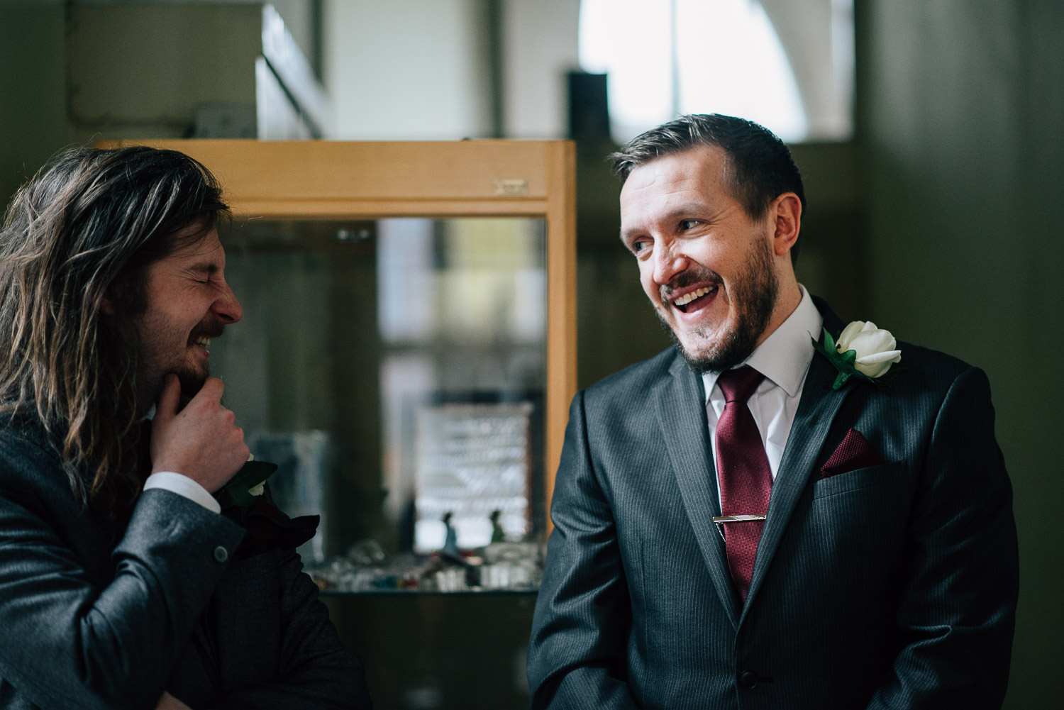 ushers laughing at ceremony in bradford on avon by bath wedding photographer the shannons photography