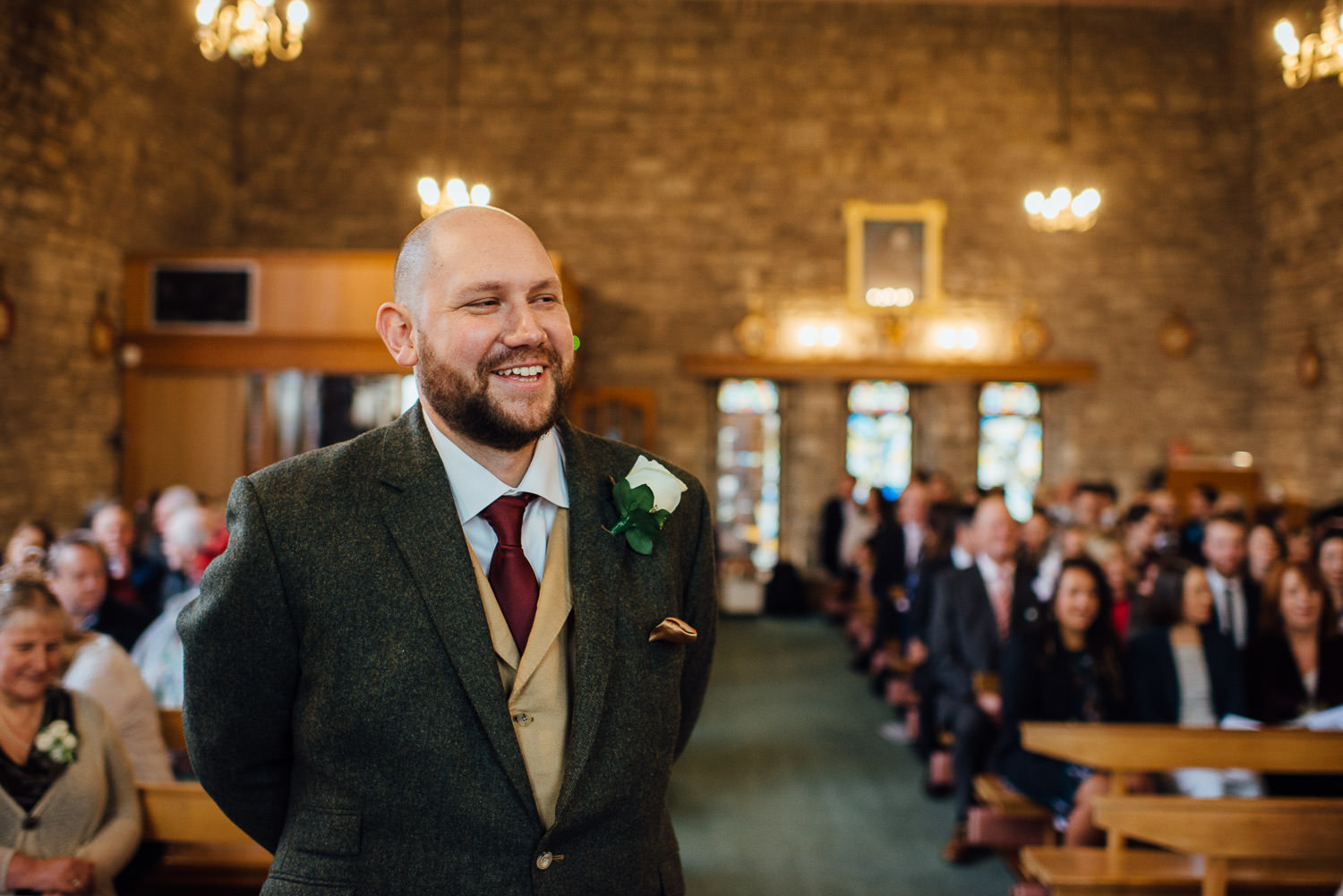 groom waiting for bride at bradford on avon church by bath wedding photographer the shannons photography