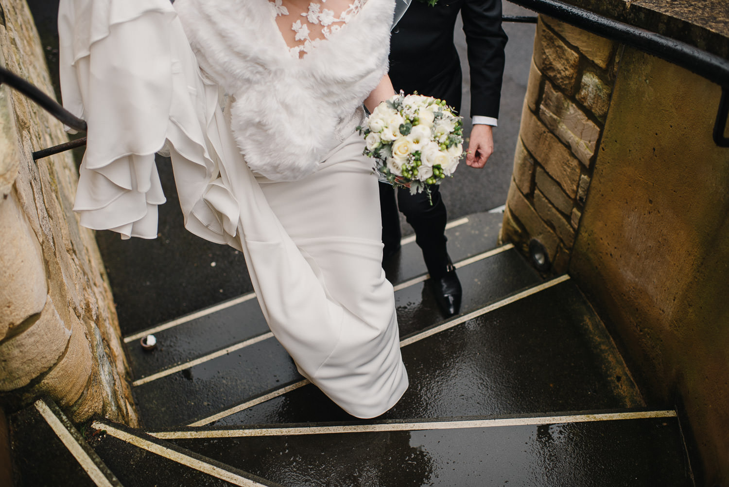 bride walking up church steps by bath wedding photographer the shannons photography