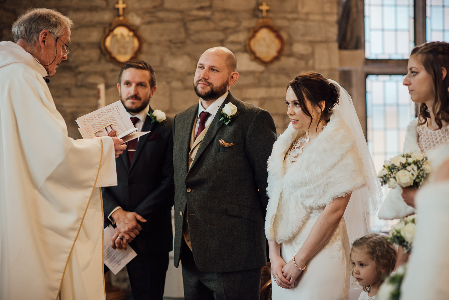 bride and groom saying vows in wedding by bath wedding photographer the shannons photography