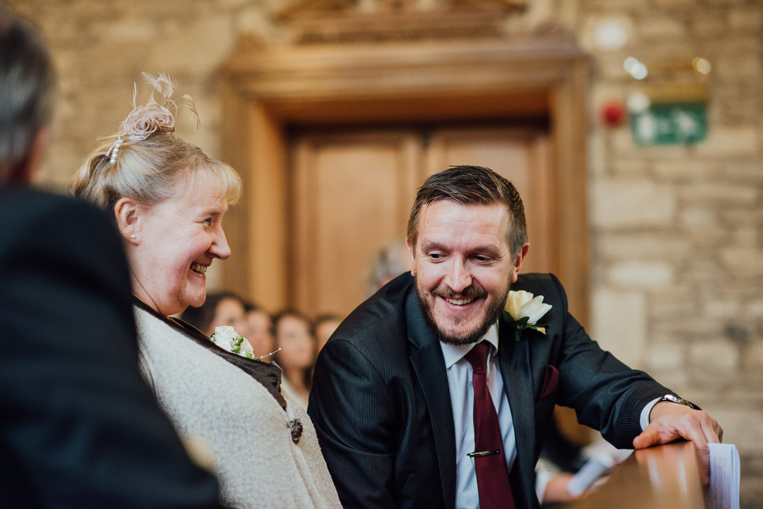 ushers smiling at guests in ceremony by bath wedding photographer the shannons photography