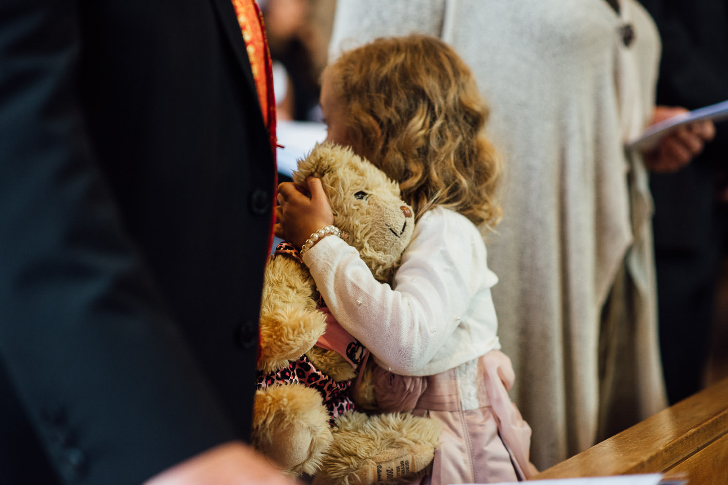 flower girl hugging teddy in ceremony by bath wedding photographer the shannons photography