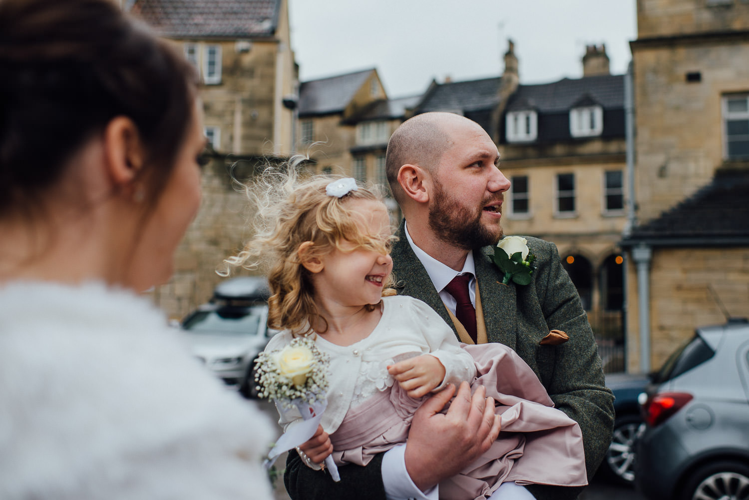 flower girl laughing at groom by bath wedding photographer the shannons photography
