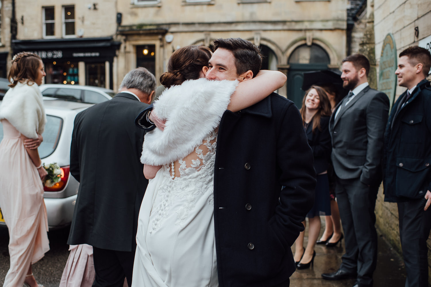guests hugging groom by bath wedding photographer the shannons photography
