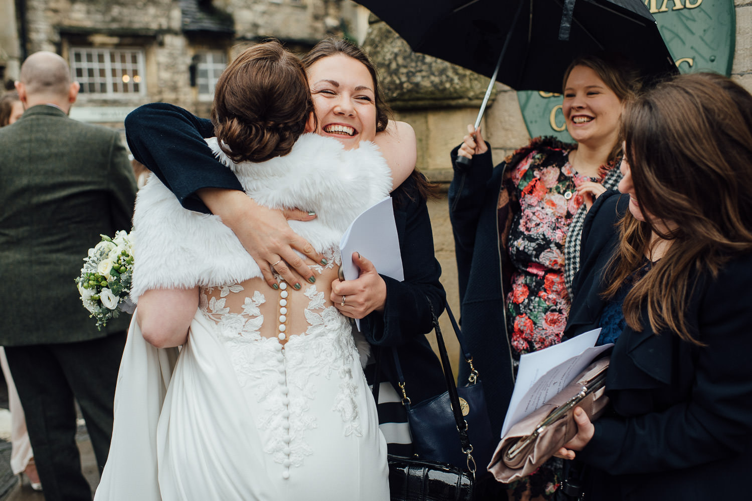 guests hugging bride by bath wedding photographer the shannons photography