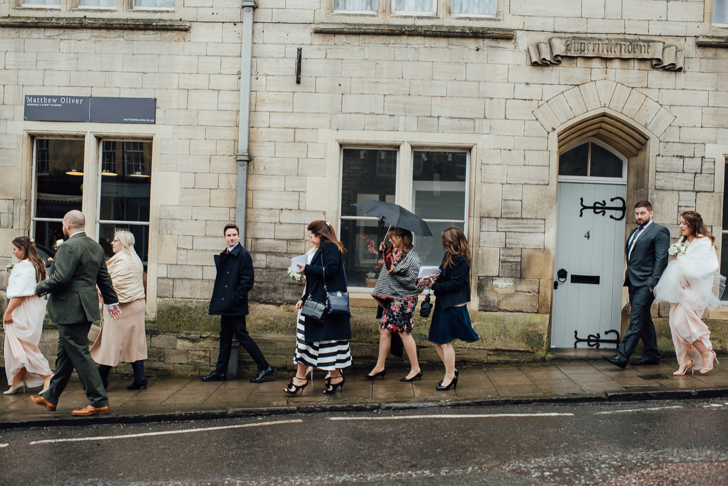wedding guests walking in bath by bath wedding photographer the shannons photography