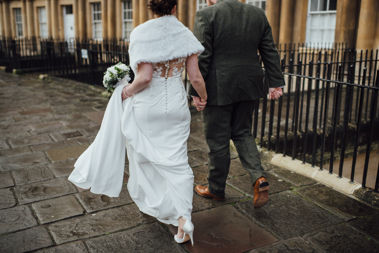 bride and groom walking to circus bath by bath wedding photographer the shannons photography